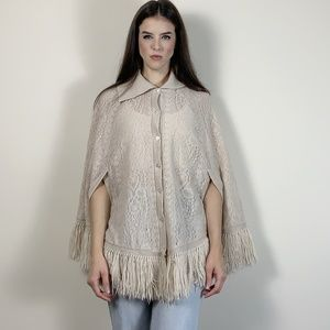 Vintage cream knit 70s poncho with fringe. Small
